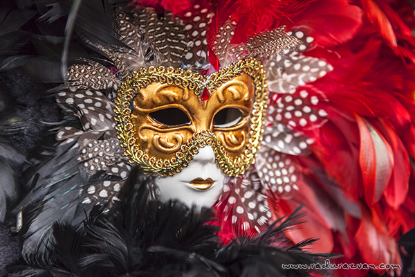 Close-up image of a colorful Venetian mask.