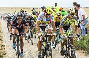 Quievy,France - July 07, 2015: Some of the biggest favourites of Le Tour de France 2015 (Contador,Sagan,Froome,Degenkolb,Martin,and Nibali) riding in full effort on a cobblestoned road during the stage 4.