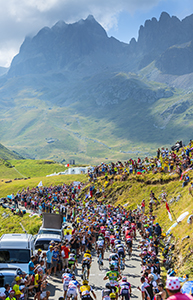 Col du Glandon, France - 23 July 2015: The peloton riding in a beautiful curve at Col du Glandon in Alps during the stage 18 of Le Tour de France .
