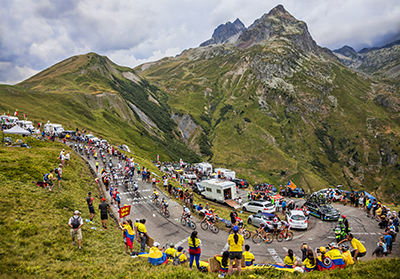Col du Glandon, France - 24 July 2015: The peloton riding in a beautiful curve at Col du Glandon in Alps during the stage 19 of Le Tour de France .
