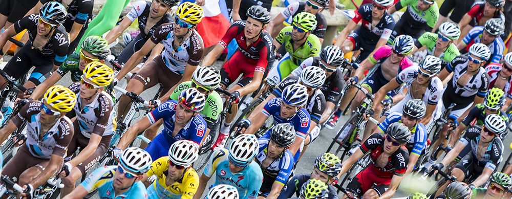 Col de Peyresourde,France- July 23, 2014: Upper view of the peloton climbing the road to Col de Peyresourde in Pyrenees Mountains during the stage 17 of Le Tour de France on 23 July 2014.