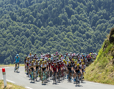 Col D'Aspin,France- July 15,2015: The peloton climbing the road to Col D'Aspin in Pyrenees Mountains during the stage 11 of Le Tour de France .