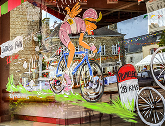 Plumelec, France - 12 July, 2015: Funny window shop decoration in Plumelec during the Team Time Trial stage - Tour de France .