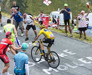 Col du Glandon, France - July 24, 2015: The British cyclist Chris Froome of Team Sky in Yellow Jersey,climbing the road to Col du Glandon in Alps, during the stage 19 of Le Tour de France .