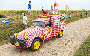 Quievy,France - July 07, 2015: Cochonou Caravan during the passing of the Publicity Caravan on a cobblestoned road in the stage 4 of Le Tour de France. Cochonou is an important French brand of short dry sausages.